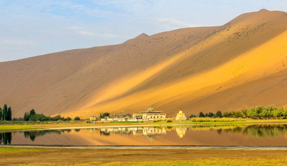 Photograph of one of the lakes within the sand dunes of the Badain Jaran Desert of China